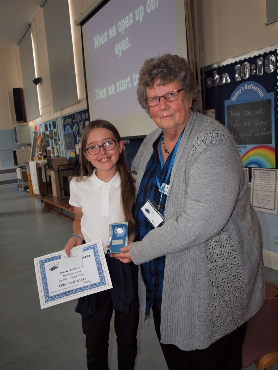 Chloe Matravers winner 7 - 9 yrs - receiving her prize at Greenfylde School from Gill Walker - Trustee